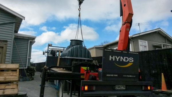 Plastic Water Tank Hiab Delivery in Driveway